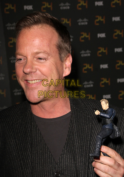 "KIEFER SUTHERLAND.""24"" 150th Episode & Season 7 Premiere Party held at XIV, Hollywood, California, USA..January 6th, 2009.headshot portrait black stubble facial hair toy figurine .CAP/ADM/KB.©Kevan Brooks/AdMedia/Capital Pictures."