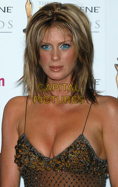 RACHEL HUNTER.Photo room at the Pantene Pro-V Awards, at the Royal Albert Hall, , London, UK..October 22nd, 2002.headshot portrait brown cleavage blue eyeliner.CAP/PL.©Phil Loftus/Capital Pictures
