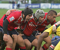 Chile's front row Joaquin Carrasco, Mathias Prado and Rafael Richard prepare to engage with their Zimbabwe opponents during the 7th place play-off in Division B of the Under 19 Rugby World Championship at Gibson Park Malone 2007.