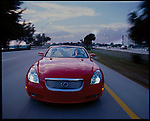 1 MARCH, 2003 -- Key Biscayne, Florida. -- Susan a writer for Lexus magazine tests out the new Lexus SC430 on Key Biscayne, Florida overlooking the Brickell Avenue skyline..©2003 ANDREW KAUFMAN