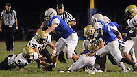 Truman defenders dive onto a loose football after Bensalem quarterback Kenny O'Connell fumbled in the third quarter at Bensalem High School Saturday September 19, 2015 in Bensalem, Pennsylvania.  (Photo by William Thomas Cain)