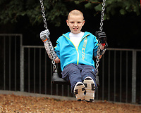 Pictured: Alan Gifford on a swing. Friday 18 August 2017<br /> Re: 11 year old Alan Gifford who has two prosthetic arms, Loughor near Swansea, Wales, UK.