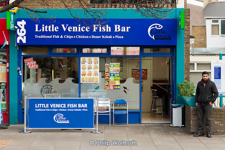 Little Venice Fish Bar owner Yaquub Aiobi. Westbourne Parade after shopfront, pavement and street furniture improvement scheme.