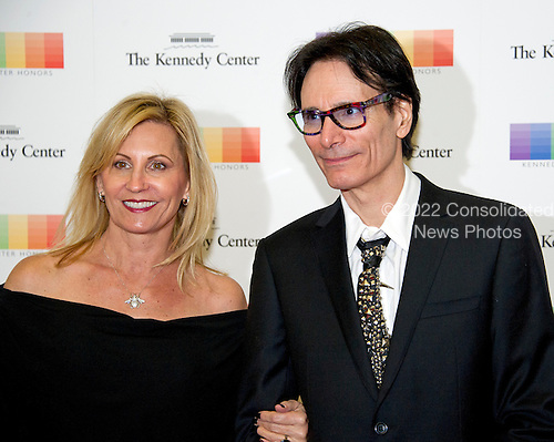 American guitarist, composer, singer, songwriter, and producer Stephen Vai and guest arrive for the formal Artist's Dinner honoring the recipients of the 39th Annual Kennedy Center Honors hosted by United States Secretary of State John F. Kerry at the U.S. Department of State in Washington, D.C. on Saturday, December 3, 2016. The 2016 honorees are: Argentine pianist Martha Argerich; rock band the Eagles; screen and stage actor Al Pacino; gospel and blues singer Mavis Staples; and musician James Taylor.<br /> Credit: Ron Sachs / Pool via CNP