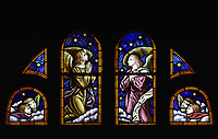 Angels, detail from a stained glass window, 1930s, in the Eglise Notre-Dame-de-la-Visitation, a catholic church built 1878-79 in Neo Romanesque style by Gedeon Leblanc, 1832-1905, in Champlain, Mauricie, on the Chemin du Roy, Quebec, Canada. The interior was designed in 1881 by Louis-Joseph Bourgeois, 1856-1930. The Chemin du Roy or King's Highway is a historic road along the Saint Lawrence river built 1731-37, connecting communities between Quebec City and Montreal. Picture by Manuel Cohen