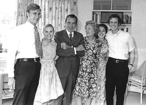 "Washington, DC -- White House Photo from 7 August, 1974 of the Nixon Family prior to the President's announcement of his resignation. (L-R) Edward Cox; Tricia (Nixon) Cox; United States President Richard Nixon; Mrs. Richard Nixon (Patricia or ""Pat""); Julie (Nixon) Eisenhower; and David Eisenhower..Credit: The White House via CNP"