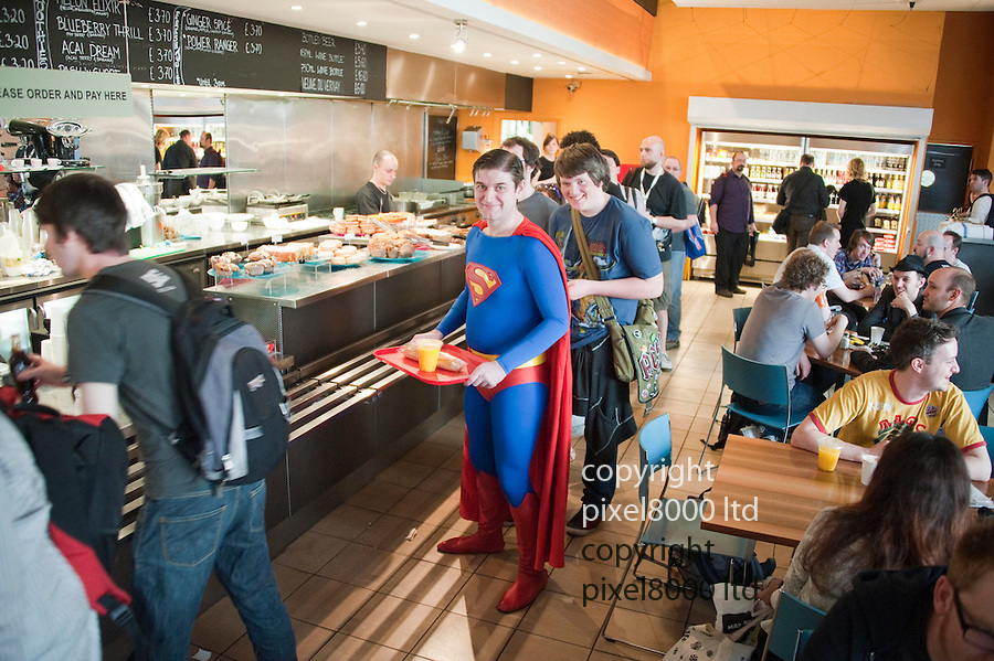 Kapow Comic convention in London today 10.4.11.People dressed as various character from comics and sci fi films attend the convention ..Paul Nurse a charity treasurer from London queue for lunch of orange and a cheese baguette in the canteen dressed a Superman......pic by Gavin Rodgers/ Pixel 8000.07917221968