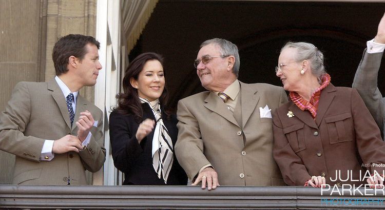 Prince Henrik, Crown Prince Frederik & Mary Donaldson appear on the balcony of The Amalienborg Palace in Copenhagen to celebrate The Queen of Denmark's 64th birthday..