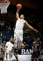 Justin Cobbs of California prepares to dunk the ball during the game against Coppin State at Haas Pavilion in Berkeley, California on November 8th, 2013.    California defeated Coppin State, 83-64.