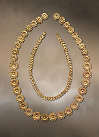 Mycenaean gold necklace from the Mycenaean cemetery of Midea tholos tomb , Dendra, Greece. National Archaeological Museum Athens.<br /> <br /> Inside mycenaean necklace has gold ivy leaf beads, Cat No 7354. The outer mycenaean necklace has rosette shaped gold beads, Cat No 7342. 15th-14th century BC.