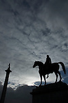 Statue of Charles 1st on horseback and Nelson?s Column in silhouette, Trafalgar Square, London UK