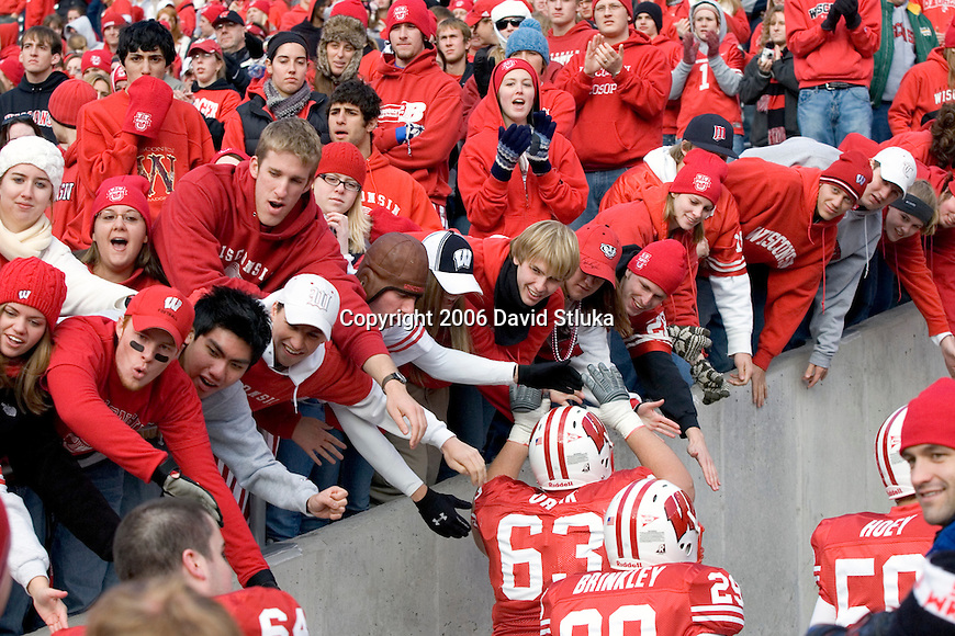 MADISON, WI - NOVEMBER 18: Fans of the Wisconsin Badgers cheer as the team leaves the field after the game against the Buffalo Bulls at Camp Randall Stadium on November 18, 2006 in Madison, Wisconsin. The Badgers beat the Bulls 35-3. (Photo by David Stluka)