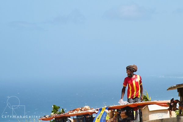 Barbados - Male vendor selling to tourists on a windswept Cherry Tree Hill with dreadlocks