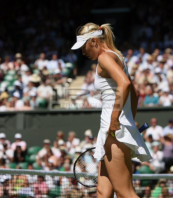 Maria Sharapova is dejected after defeat to Gisela Dulko, Ladies' Singles - 2nd Round Maria Sharapova (RUS)[24]. v. Gisela Dulko(ARG)  on Day 3   of The Wimbledon Tennis Championships 2009:  23/06/2009. Picture By Marcello Pozzetti - mob:07973308835 - © IPS Photo Agency - 21 Delisle Road  London SE28 0JD