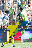 Columbus Crew forward Emilio Renteria (20) pushes Seattle Sounders FC defender Jhon Kennedy Hurtado (34) while trying to take control of the ball at CenturyLink Field in Seattle, Washington. The Sounders defeated Columbus Crew, 6-2.