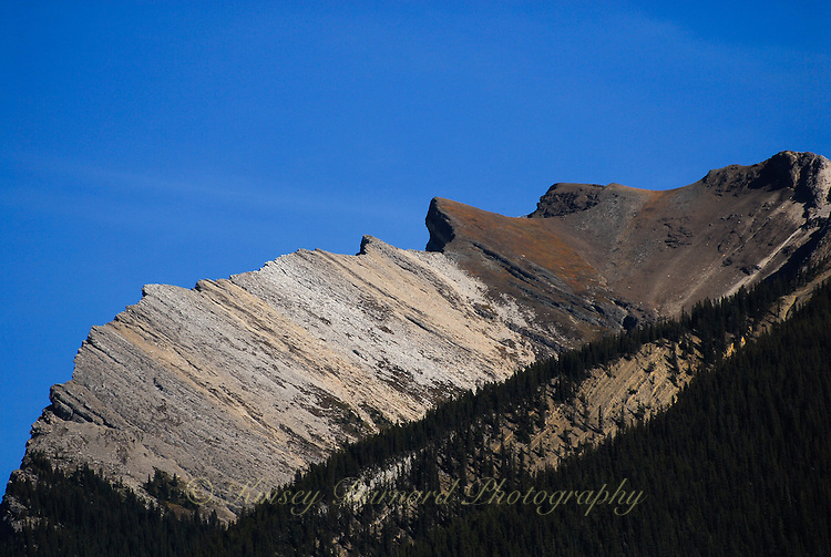 Dramatic Palisades Mountains thrusting into the blues skies of Jasper National Park