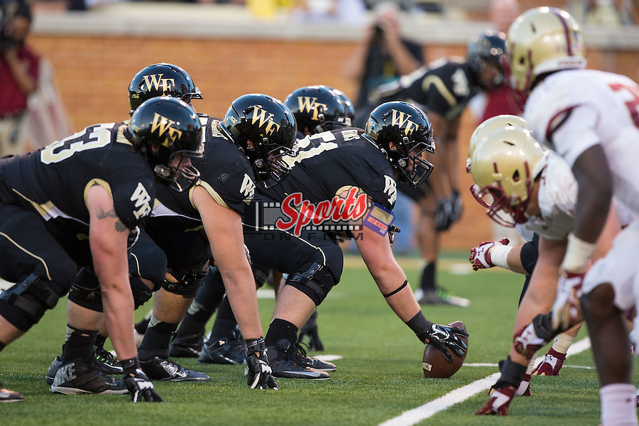 Cory Helms (51) of the Wake Forest Demon Deacons prepares the snap the ball during second half action against the Boston College Eagles at BB&T Field on October 25, 2014 in Winston-Salem, North Carolina.  The Eagles defeated the Demon Deacons 23-17.  (Brian Westerholt/Sports On Film)