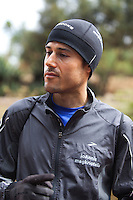 Ioannis Magkriotellis, a Greek marathon runner training in  Iten. He is hoping to improve his time  enough through high altitude training to qualify for  the Olympics on Greece's team. International athletes have flocked to Iten hoping to gain  advantages from training with the world's fastest  distance runners.