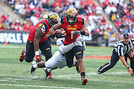College Park, MD - October 1, 2016: Maryland Terrapins wide receiver D.J. Moore (1) is tackled by a Purdue Boilermakers defender during game between Purdue and Maryland at  Capital One Field at Maryland Stadium in College Park, MD.  (Photo by Elliott Brown/Media Images International)