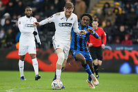 (L-R) Oli McBurnie of Swansea City challenged by Regan Charles-Cook of Gillingham during the FA Cup Fourth Round match between Swansea City and Gillingham at the Liberty Stadium, Swansea, Wales, UK. Saturday 26 January 2019