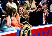 New York, NY - September 2, 2004 --  Former United States President George H.W. Bush, right, photographs his granddaughter, Barbara, left, as Jenna Bush, center, looks on and laughs, at the 2004 Republican Convention in Madison Square Garden in New York on September 2, 2004.  Barbara and Jenna Bush are the twin daughters of United States President George W. Bush..Credit: Ron Sachs / CNP.(RESTRICTION: No New York Metro or other Newspapers within a 75 mile radius of New York City)