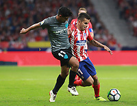 Atletico Madrid's Argentinian forward Angel Correa; Malaga's defender Gonzalo Castro