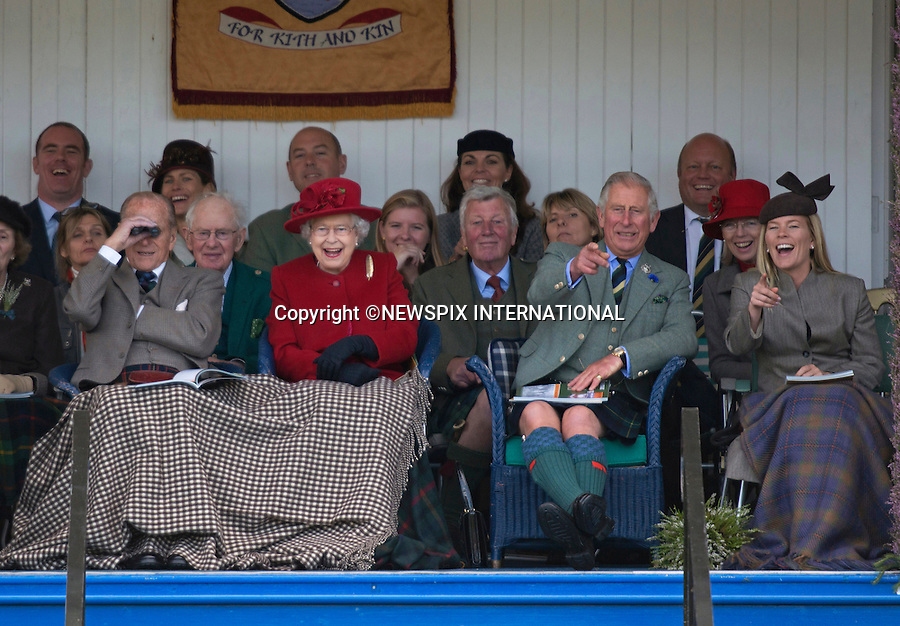 05.09.2015; Braemar, Scotland: ROYAL LAUGHTER AT HIGHLAND GAMES<br /> Queen Elizabeth, Prince Charles and Autumn Phillips were in fits of laughter as they watched the children participate in the sack race. <br /> The Royals who included The Queen, Duke of Edinburgh, Prince Charles, Peter Philips and wife Autumn were attending the 200th Braemar Highland Gathering.<br /> Mandatory Photo Credit: &copy;NEWSPIX INTERNATIONAL<br /> <br /> **ALL FEES PAYABLE TO: &quot;NEWSPIX INTERNATIONAL&quot;**<br /> <br /> PHOTO CREDIT MANDATORY!!: NEWSPIX INTERNATIONAL(Failure to credit will incur a surcharge of 100% of reproduction fees)<br /> <br /> IMMEDIATE CONFIRMATION OF USAGE REQUIRED:<br /> Newspix International, 31 Chinnery Hill, Bishop's Stortford, ENGLAND CM23 3PS<br /> Tel:+441279 324672  ; Fax: +441279656877<br /> Mobile:  0777568 1153<br /> e-mail: info@newspixinternational.co.uk
