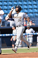 Charleston RiverDogs first baseman Chris Gittens (34) gives thanks after hitting a home run during game one of a double header against the Asheville Tourists at McCormick Field on July 8, 2016 in Asheville, North Carolina. The RiverDogs defeated the Tourists 10-4 in game one. (Tony Farlow/Four Seam Images)