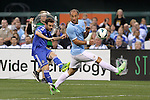 23 May 2013:  Juan Mata (left)(ESP) of Chelsea kicks the ball past Pablo Zabaleta (right)(ARG) of Manchester City.   Chelsea F.C. was defeated by Manchester City 3-4 at Busch Stadium in Saint Louis, Missouri, in a friendly exhibition soccer match.