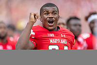 Landover, MD - September 1, 2018: Maryland Terrapins defensive back Kenny Bennett (24) reacts to teammate Jeshaun Jones 65 yard touchdown run during game between Maryland and No. 23 ranked Texas at FedEx Field in Landover, MD. The Terrapins upset the Longhorns in back to back season openers with a 34-29 win. (Photo by Phillip Peters/Media Images International)