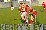 Duagh's Joey Shanahan gets the ball away inspite of the close attention of Tarberts Danal Leahy & John Kelliher.