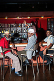 JAMAICA, Port Antonio. The Jolly Boys having a drink at the Bush Bar, Geejam Hotel.