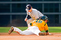 Shortstop Derek Hamilton #4 of the Rice Owls applies the tag as Brooks Pinckard #16 of the Baylor Bears slides head first into second base at Minute Maid Park on March 6, 2011 in Houston, Texas.  Photo by Brian Westerholt / Four Seam Images