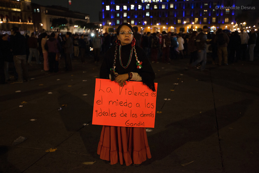 Tens of thousand of protesters gather on Zocalo, the city's main square, during a massive march in support of the 43 missing Ayotzinapa's students, on a day normally reserved for the celebration of Mexico's 1910-17 Revolution, in Mexico City, Mexico on November 20, 2014. Parents of the 43 missing students still do not believe the official line that the young men are all dead. Criticism of the government has intensified in Mexico and the country has been convulsed by protests. Many are demanding justice and that the search for the 43 missing students continue until there is concrete evidence to the contrary. Mexico officially lists more than 20 thousand people as having gone missing since the start of the country's drug war in 2006, and the search for the missing students has turned up other, unrelated mass graves.(Photo by BénédicteDesrus)