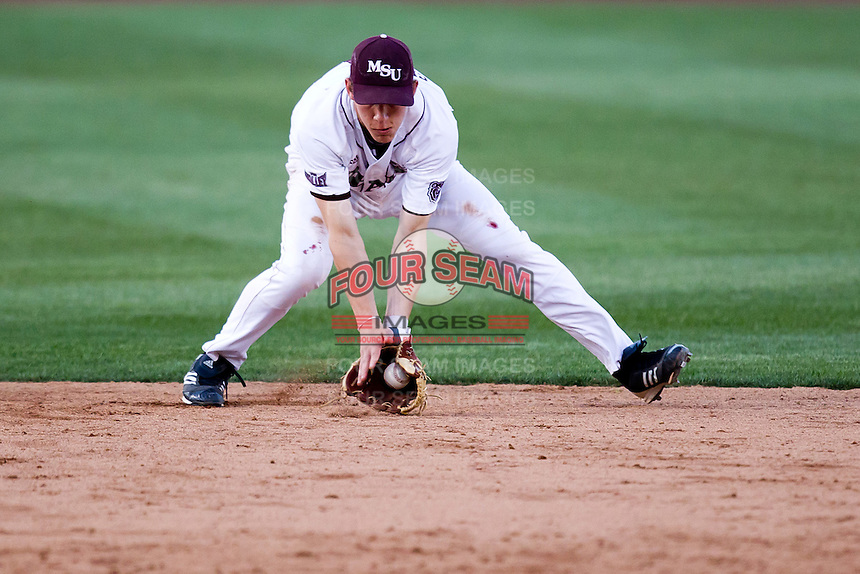 Eric Cheray (14) of the Missouri State Bears fields a ground ball during a game against the Oklahoma State Cowboys at Hammons Field on March 6, 2012 in Springfield, Missouri. (David Welker / Four Seam Images)