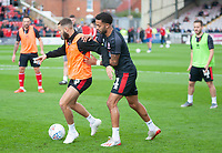 Lincoln City's Jorge Grant, left, and Bruno Andrade during the pre-match warm-up<br /> <br /> Photographer Andrew Vaughan/CameraSport<br /> <br /> The EFL Sky Bet League One - Lincoln City v Sunderland - Saturday 5th October 2019 - Sincil Bank - Lincoln<br /> <br /> World Copyright © 2019 CameraSport. All rights reserved. 43 Linden Ave. Countesthorpe. Leicester. England. LE8 5PG - Tel: +44 (0) 116 277 4147 - admin@camerasport.com - www.camerasport.com