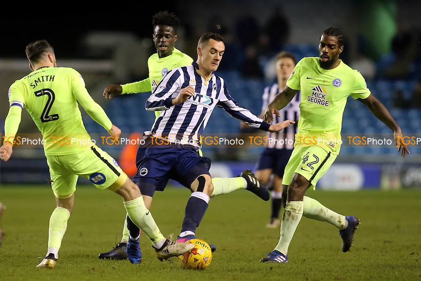 Michael Smith of Peterborough tackles Millwall's Shaun Williams during Millwall vs Peterborough United, Sky Bet EFL League 1 Football at The Den on 28th February 2017