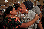 Former Colombian senator Piedad Cordoba, ( R) kisses each other with Nobel 1992 Peace Prize Laureate Rigoberta Menchu while they attend a mass during the process to receive a group of 10 hostages held for more than 12 years release by FARC members in Villavicencio, Colombia. 27/03/2012.  Photo by Nestor Silva / VIEWpress.
