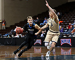SIOUX FALLS, SD - MARCH 10:  Austin Compton #31 from St. Francis drives against Riley Costen #5 from Cornerstone during their quarterfinal game at the 2018 NAIA DII Men's Basketball Championship at the Sanford Pentagon in Sioux Falls. (Photo by Dave Eggen/Inertia)