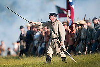 NWA Democrat-Gazette/BEN GOFF @NWABENGOFF<br /> Confederate States of America soldiers advance on the union army on Friday Sept. 25, 2015 during the Battle of Pea Ridge Civil War reenactment at Webb Farm near Pea Ridge. The event continues with battle reenactments at 2:00p.m. on Saturday and at 11:00a.m. Sunday.