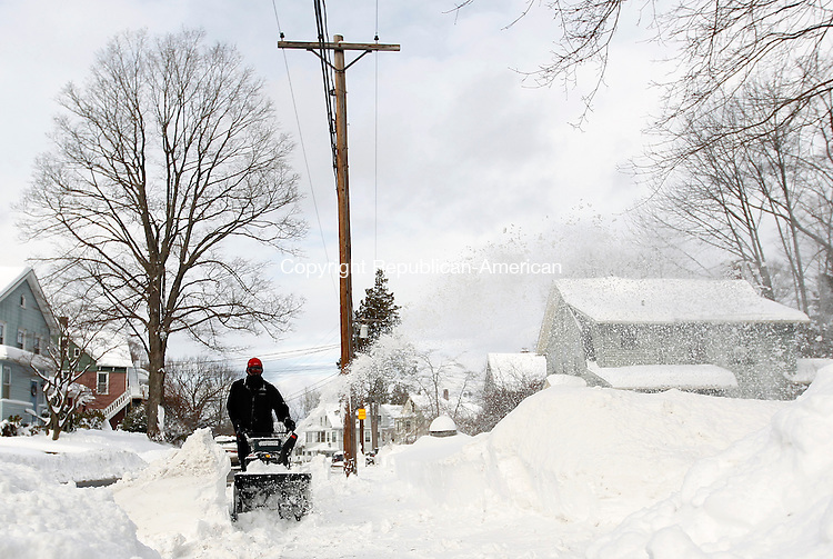 """Naugatuck, CT- 12, January 2010-011211CM14 Peter Ernsky clears the sidewalk adjacent to Hillside Ave in Naugatuck Wednesday afternoon. Ernsky, who has family in neighborhood, said he cleared three driveways amidst the storm. Area towns reported up to 30"""" of snow from  Winter Storm Benedict.  Christopher Massa Republican-American"""