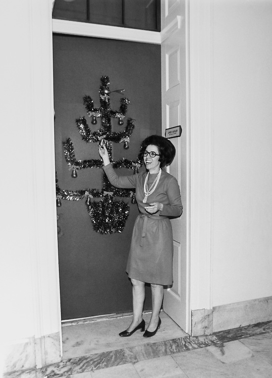 Staff member decorating Congressman's office doorway around Christmas. (Photo by Dev O'Neill/CQ Roll Call via Getty Images)