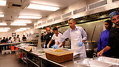 United States President Barack Obama with daughter Malia Obama, and, from left, Jamillah Linkins, Marianne Ali and Brian MacNair, participate in a service project at DC Central Kitchen, on Saturday, September 10, 2011, in Washington, DC.  .Credit: Leslie E. Kossoff / Pool via CNP