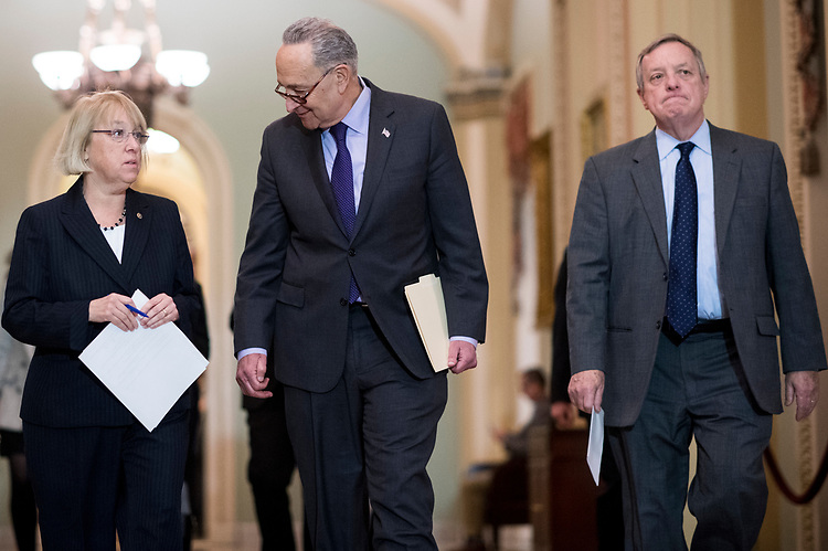 UNITED STATES - JANUARY 17: From left, Sen. Patty Murray, D-Wash., Senate Minority Leader Chuck Schumer, D-N.Y., and Sen. Richard Durbin, D-Ill., arrive to speak to reporters in the Ohio Clock Corridor after the Senate Democrats' policy lunch on Wednesday, Jan. 17, 2018. (Photo By Bill Clark/CQ Roll Call)