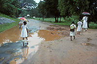 Girls negotiate puddles in Sri Lanka in 1996.