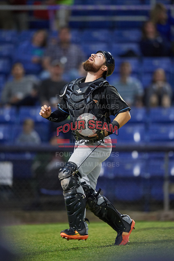 Akron RubberDucks catcher Eric Haase (13) makes a play on a foul ball during a game against the Binghamton Rumble Ponies on May 12, 2017 at NYSEG Stadium in Binghamton, New York.  Akron defeated Binghamton 5-1.  (Mike Janes/Four Seam Images)