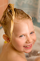 Blond blue eye Toddler Girl head shot in bath tu