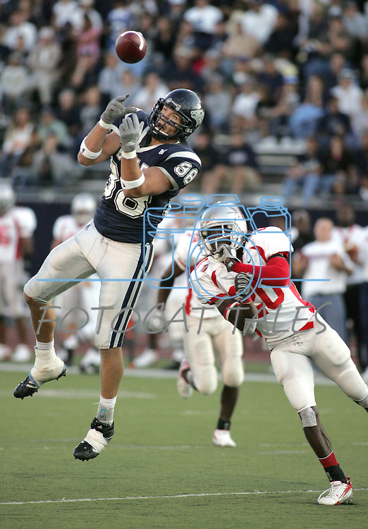 Nevada's Adam Bishop tries to make a reception late in the first quarter against Nicholls State defender Ladarius Webb on Sept. 15, 2007, in Reno, Nev..Photo by Cathleen Allison