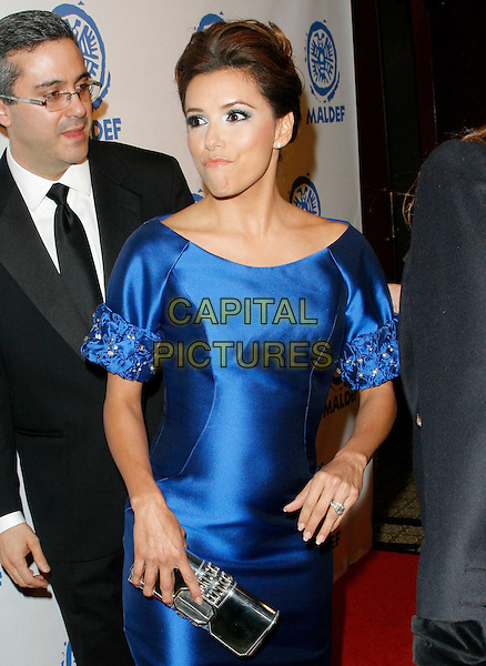 EVA LONGORIA PARKER.at The MALDEF 35th Annual Los Angeles Awards Gala held at The Westin Bonaventure Hotel in Los Angeles, California, USA,.November 12th 2009.  .half length dress blue silk satin silver  beaded sleeves cuffs clutch bag    hand ring wedding funny mouth                                     .CAP/RKE/DVS.©DVS/RockinExposures/Capital Pictures.