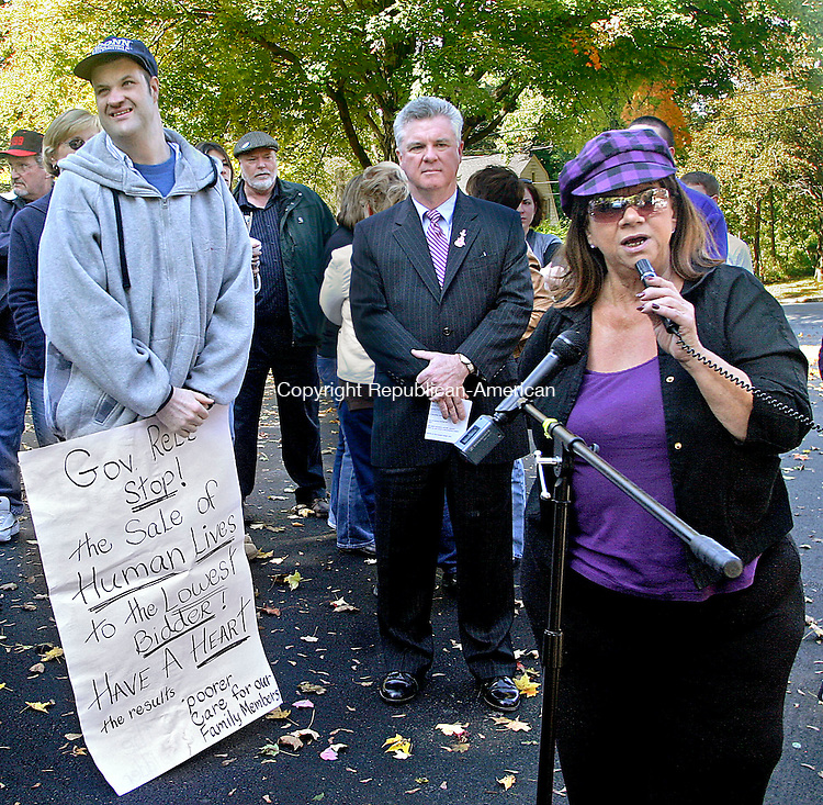 WATERBURY, CT.-07 OCTOBER 2009-100709DA09- Judi Walters, right, speaks on behalf of her son Paul Barnard, left who is a resident of Migeon Hall Group Home in Torrington, which could be effected by Governor Jodi Rell's veto of an implementer bill that included extension of moratorium on sale of state homes to private operators. In support House speaker Chris Donovan, center,  joins District 1199 Wednesday on Irving Street in Torrington to discuss the matter.<br /> Republican-American Darlene Douty